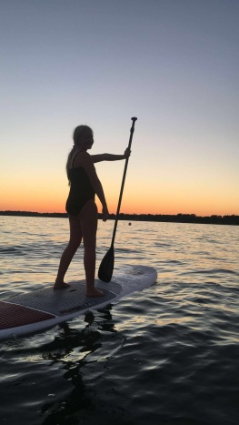 This became our nightly tradition at the lake house, watching the sun go down on paddle boards